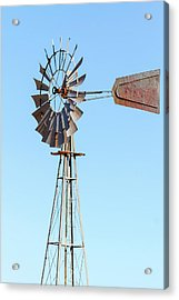 Water Pump Windmill On Blue Sky Background Acrylic Print by David Gn