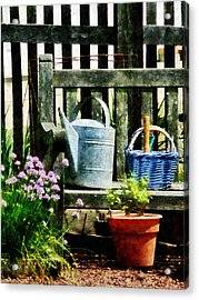 Watering Can And Blue Basket Acrylic Print by Susan Savad