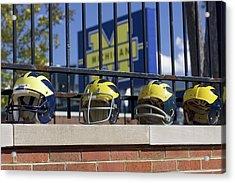 Wolverine Helmets Of Different Eras On Stadium Wall Acrylic Print