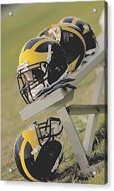 Wolverine Helmets On A Football Bench Acrylic Print