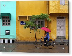 Woman Cycling In Street Acrylic Print