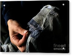Woman Fixing A Hole With A Needle And Thread Acrylic Print by Sami Sarkis