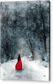 Woman In Red Cape Walking In Snowy Woods Acrylic Print by Jill Battaglia
