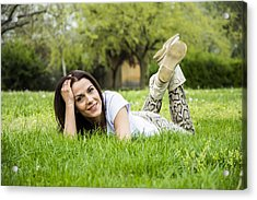 Woman Relaxing On The Grass In Springtime Acrylic Print