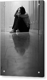 Woman Sitting In Corridor With Head In Hands Acrylic Print by Sami Sarkis