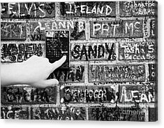 Womans Hand Pushing Old Intercom Button On Wall Covered In Graffiti Outside Graceland Memphis Acrylic Print by Joe Fox