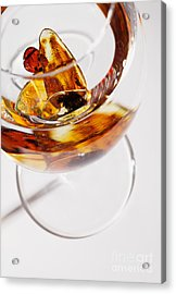 Acrylic Print featuring the photograph Yellow Amber Stones In A Glass. by Andrey  Godyaykin
