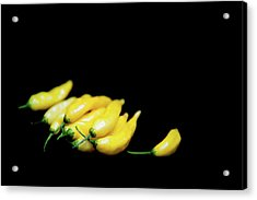 Yellow Chillies On A Black Background Acrylic Print