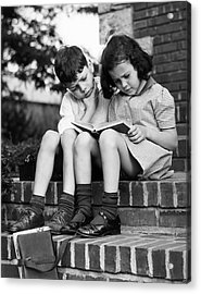 Young Boy & Girl Reading A Book Outdoors Acrylic Print by George Marks
