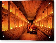Young Buddhist Monk Are Reading A Book With Light From Candle  Acrylic Print by Anek Suwannaphoom