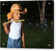 Young Cowboy Blowing Bubbles Acrylic Print