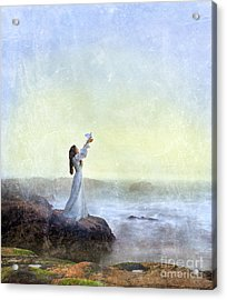 Young Lady Releasing A Dove By The Sea Acrylic Print by Jill Battaglia