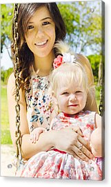 Young Mom With Her Baby Girl On A Swing Outside Acrylic Print