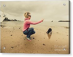 Young Woman Exercising Her Dog At The Beach Acrylic Print