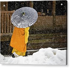 A Buddhist Monk Walks Through A Snow Acrylic Print by Mint Images - Art Wolfe