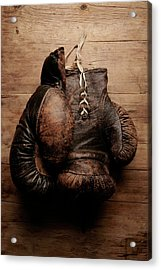 A Pair Of Worn Old Boxing Gloves On Acrylic Print by The flying dutchman