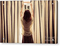 A Young Woman Is Opening The Curtains Acrylic Print
