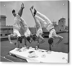 Acrobats Eat While Doing Handstands Acrylic Print by Bettmann
