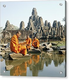 Buddhist Monks Sitting In Front Of Acrylic Print