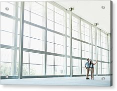 Business People Talking In Lobby Acrylic Print