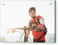 Caucasian Man Pushing Mountain Bike Acrylic Print by Mike Kemp