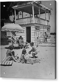 Children Playing On The Imported Sand As Acrylic Print