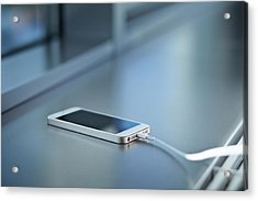 Close-up Of Smartphone Charging Acrylic Print by Klaus Vedfelt