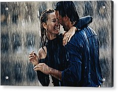 Couple Embracing In Pouring Rain Acrylic Print by Bruce Ayres