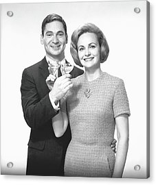 Couple Toasting Champagne In Studio Acrylic Print by George Marks
