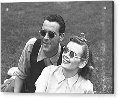 Couple Wearing Sunglasses Sitting On Acrylic Print by George Marks