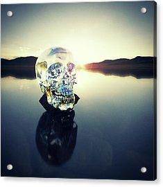 Crystal Skull Laying On Rock In Lake Acrylic Print by Doug Armand