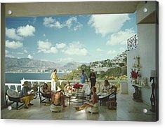 Guests At Villa Nirvana Acrylic Print by Slim Aarons