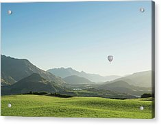 Hot Air Balloon Flying Above Rolling Acrylic Print by Jacobs Stock Photography Ltd