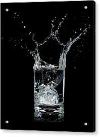 Ice Splashing Into Water Glass Acrylic Print by Chris Stein