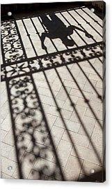Mans Shadows Near Ornate Iron Fence Acrylic Print