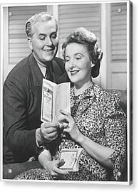 Mature Couple Looking At Brochure, B&w Acrylic Print by George Marks