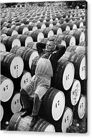Mature Man Relaxing On Barrels B&w Acrylic Print