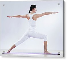 Mid Adult Woman Doing Yoga Against Acrylic Print by Westend61