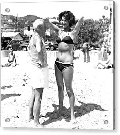Picasso And Bikini-clad Woman On The Acrylic Print by Hulton Archive