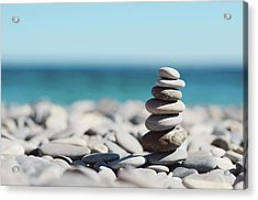 Pile Of Stones On Beach Acrylic Print