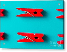 Red Clothespins On Cyan Background Acrylic Print by Zamurovic Photography
