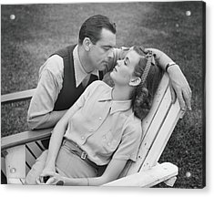 Romantic Couple Relaxing On Deckchair Acrylic Print by George Marks
