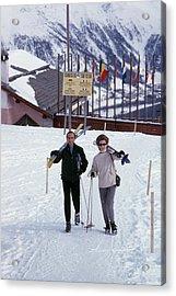 Skiers At St. Moritz Acrylic Print by Slim Aarons