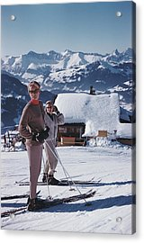 Skiers In Gstaad Acrylic Print by Slim Aarons