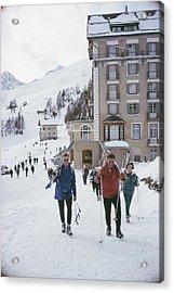 Skiers In St. Moritz Acrylic Print by Slim Aarons
