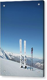Skis And Ski Poles Stuck In The Snow Acrylic Print