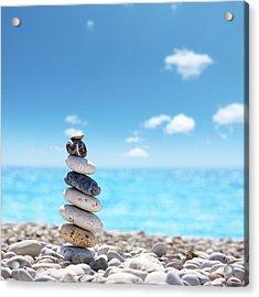 Stone Balance On Beach Acrylic Print by Imagedepotpro