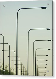 Streetlights Against Afternoon Sky Acrylic Print by By Ken Ilio