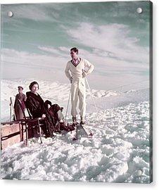 The Shah & Wife Skiing Acrylic Print by Dmitri Kessel