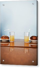 Two Cinnamon Buns And Two Glasses Of Acrylic Print by Johner Images